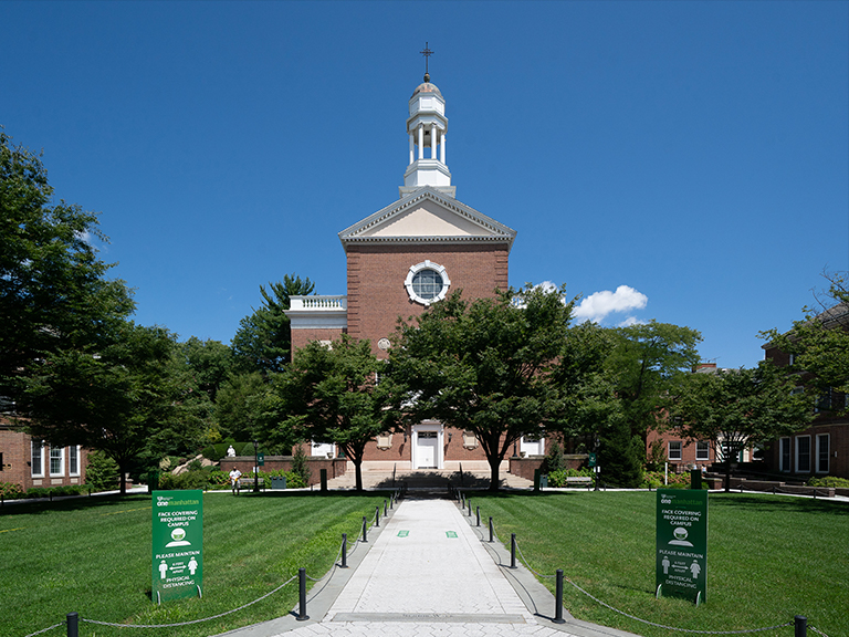 Campus image of the quad and smith auditorium on a sunny day