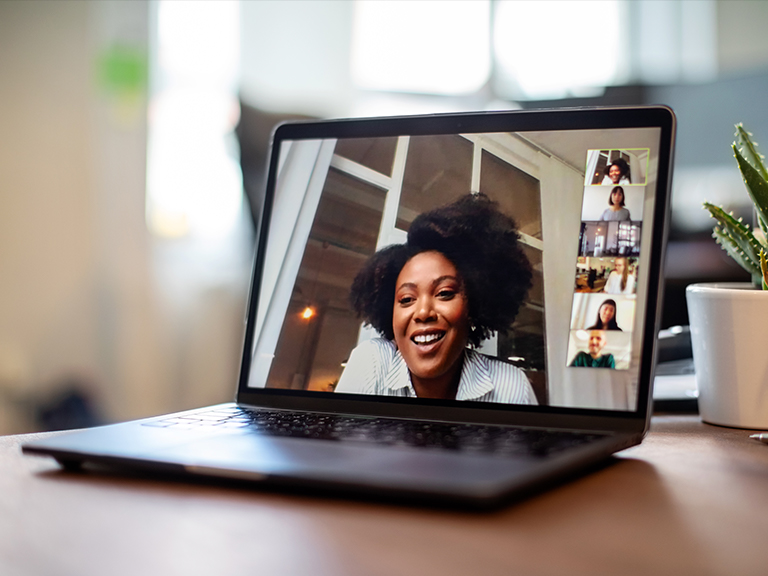 Student participating in video chat on a laptop