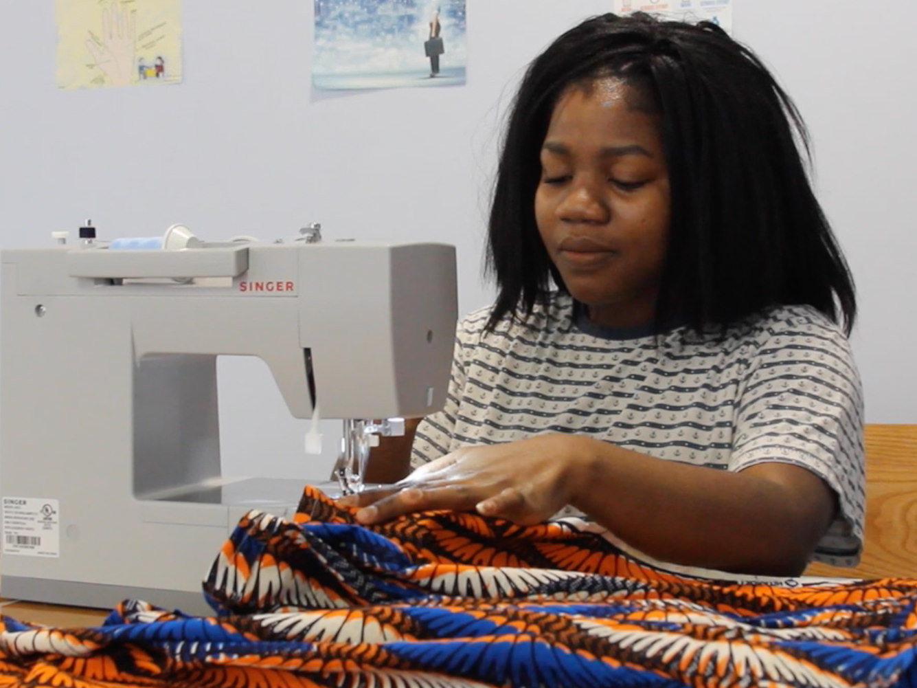 student creates clothing line with sewing machine